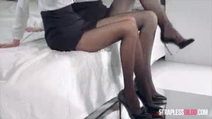 Red haired office lady in black stockings and shoes with high heels is about to cum