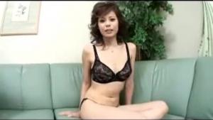 Asian brunette, Cherry Ray likes to take a massive meat stick in the hairy pussy, on the sofa